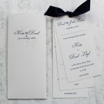 ivory wedding invitation tall wallet with information inserts tied navy bow