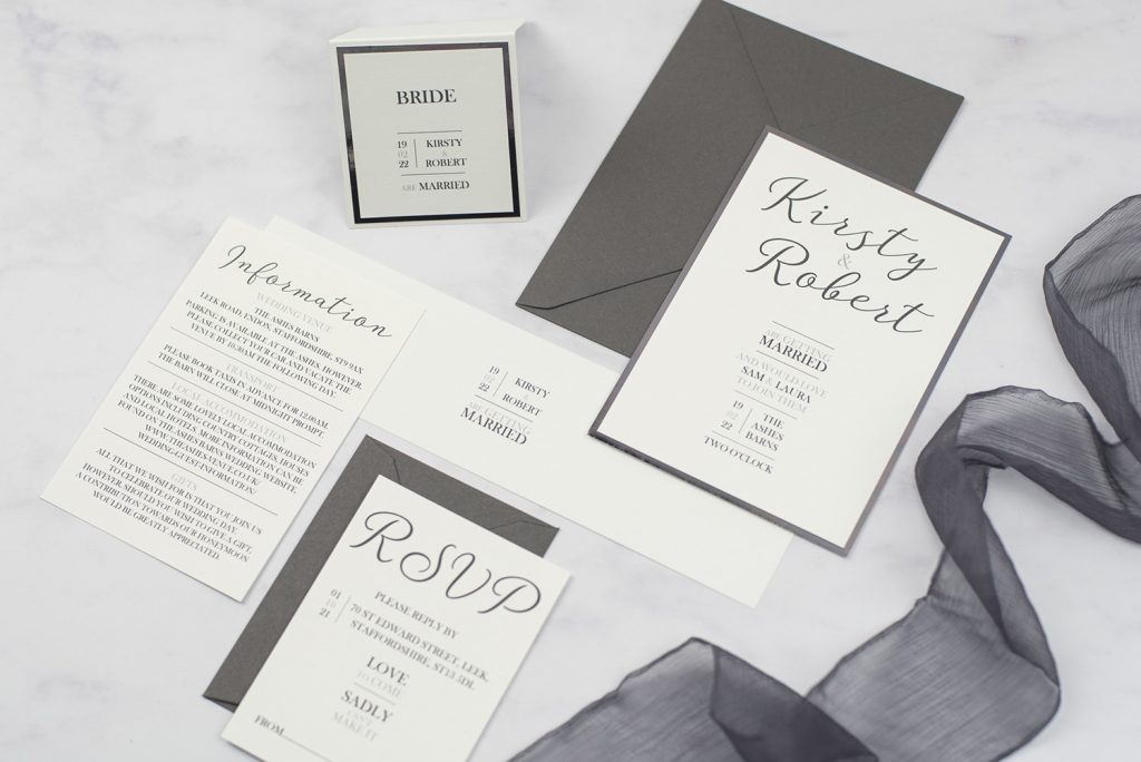 handmade wedding invitations white dark silver foil graphic font invite bellyband rsvp information