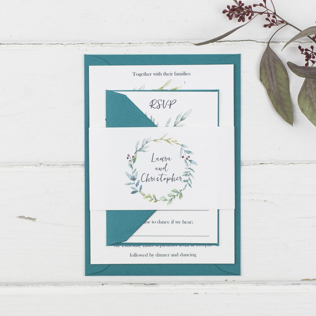types of wedding invitations handmade invite rsvp bellyband white textured painted foliage wreath teal envelopes
