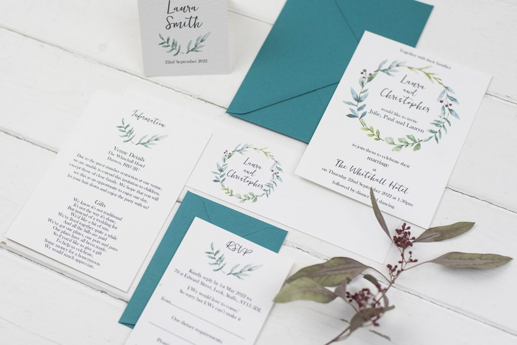 handmade wedding invitations suite white textured painted foliage wreath invite bellyband information rsvp teal envelopes