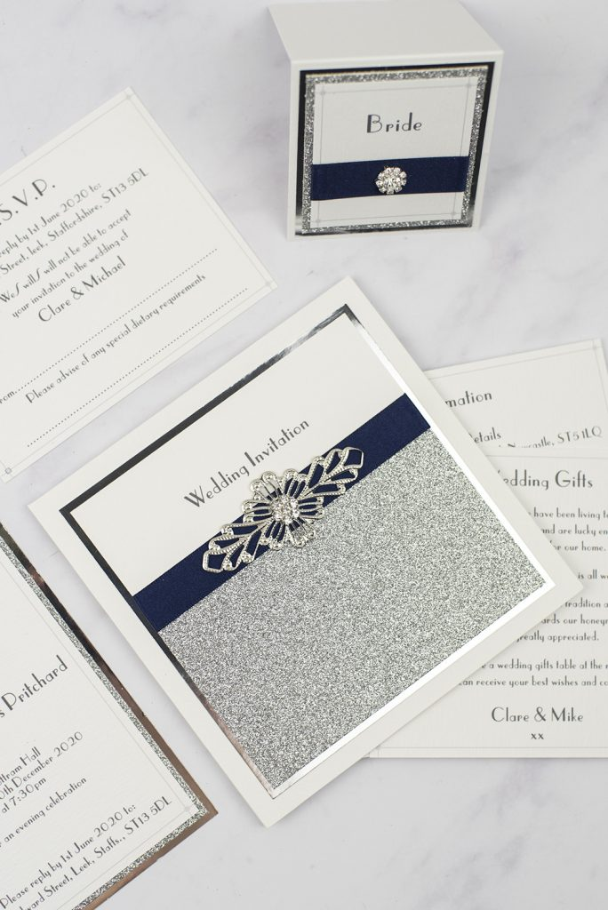 luxury wedding invitations silver glitter wire crystal embellishment pocketfold flat lay