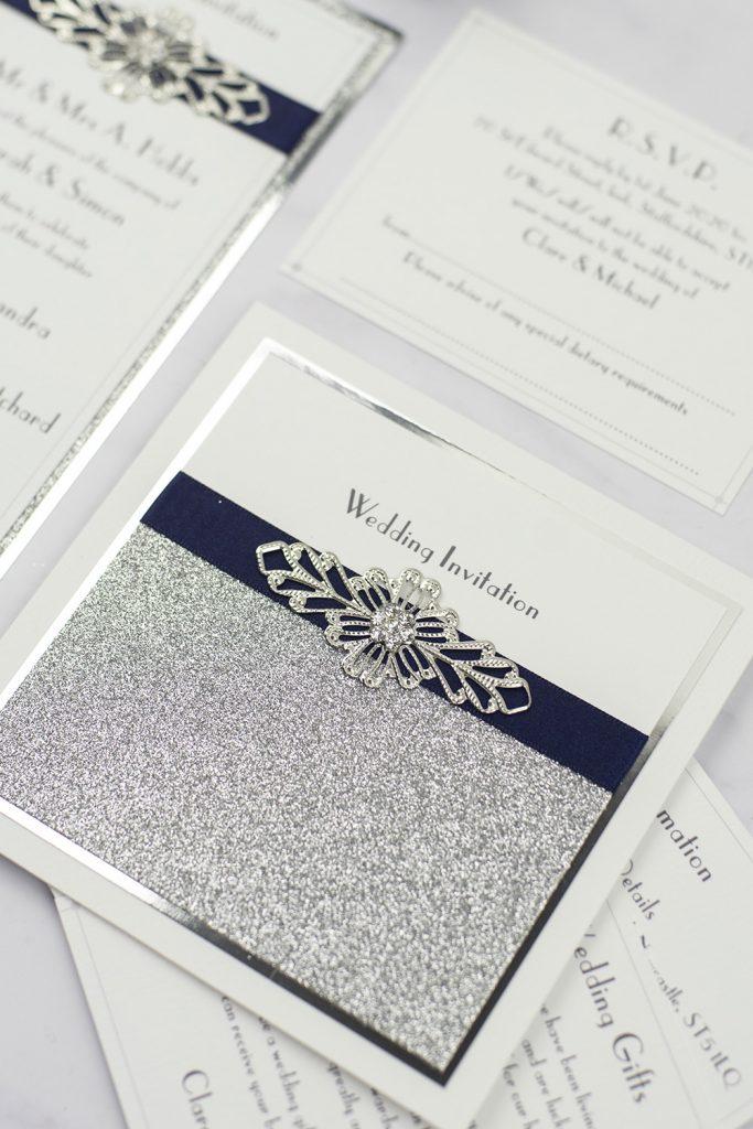 luxury wedding invitations white silver glitter foil navy ribbon wire embellishment pocketfold invitation