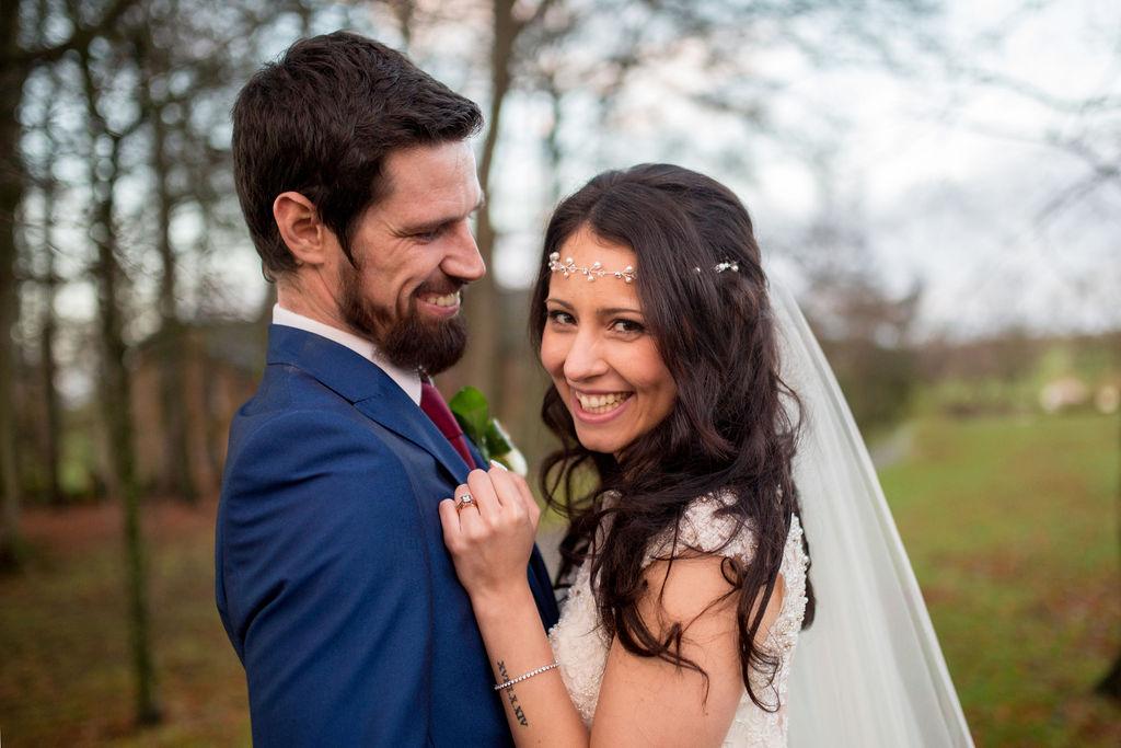 wedding checklist bride and groom close up smiling embracing