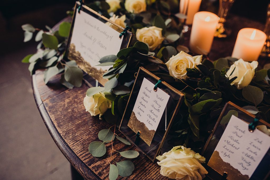wedding checklist gold frames table plan gold leaf roses foliage candles