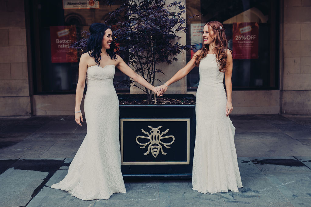wedding checklist bride and bride holding hands city centre