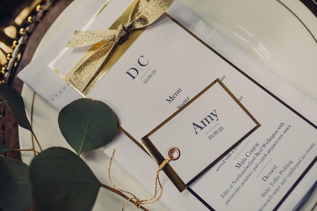 wedding checklist menu gold foil place card tag foliage plate napkin