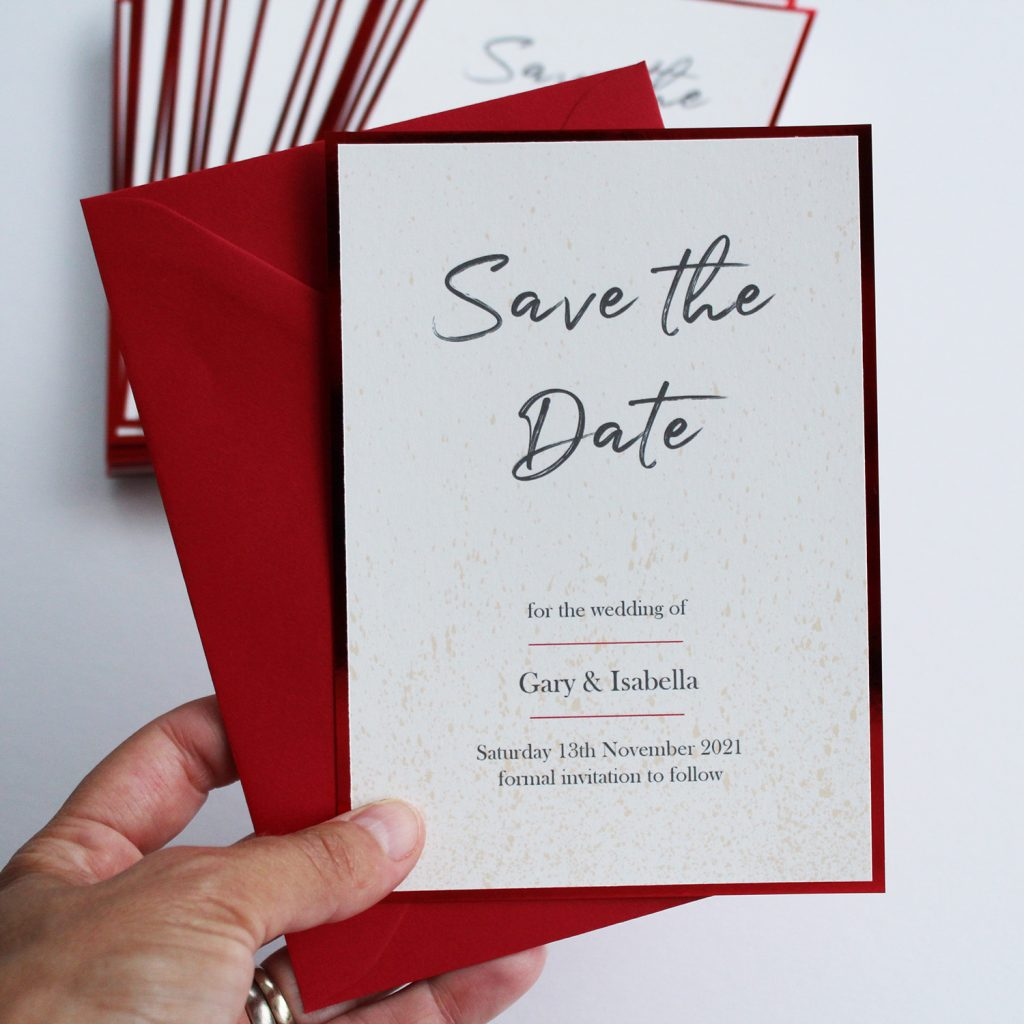 save the date ivory card red shiny edge red envelope hand held