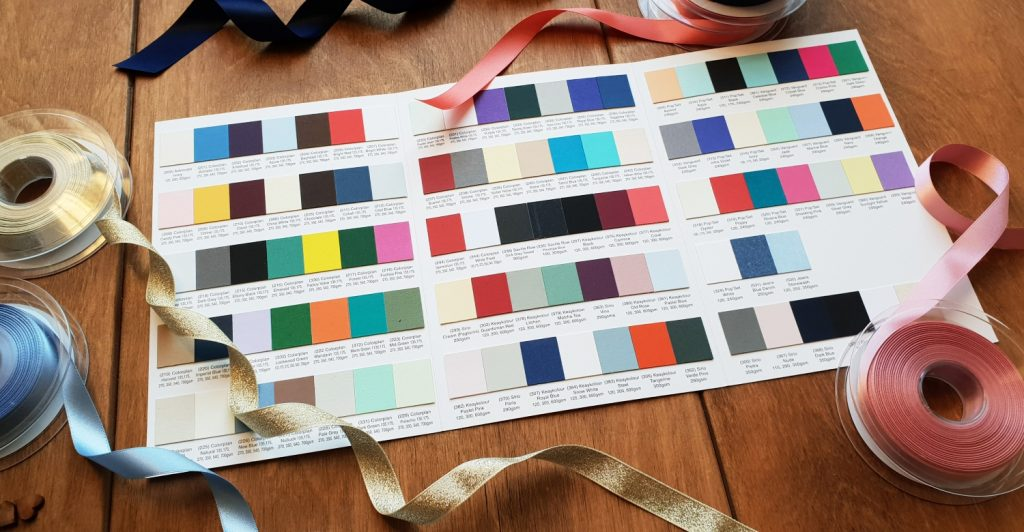 wedding invites card colour chart ribbons on table