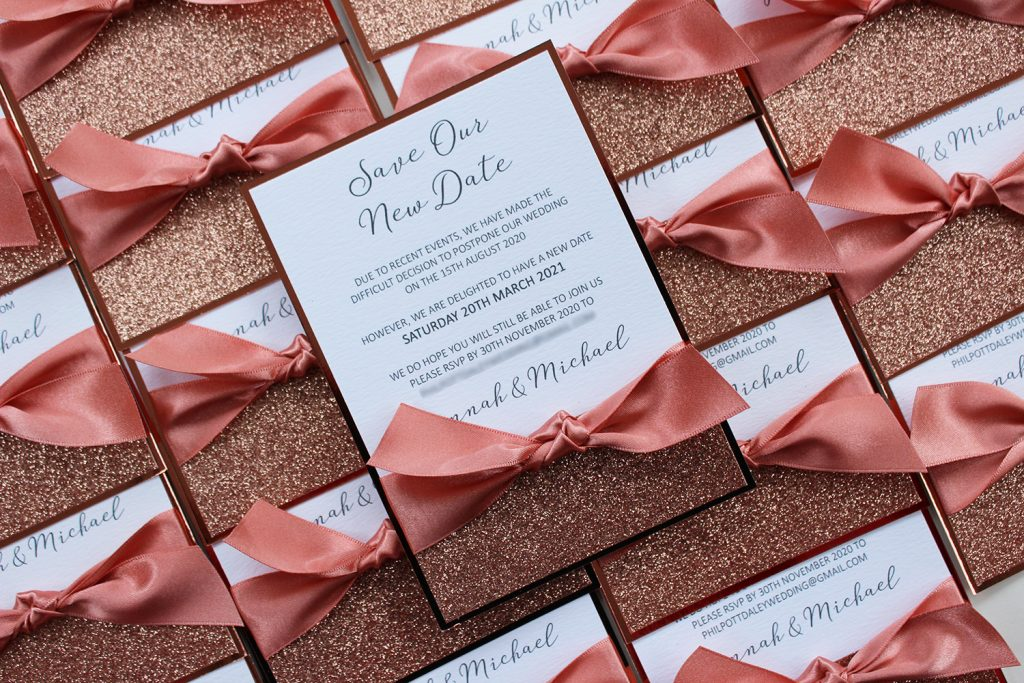 wedding save the date postponement white rose gold glitter rose pink ribbon knot lots of cards