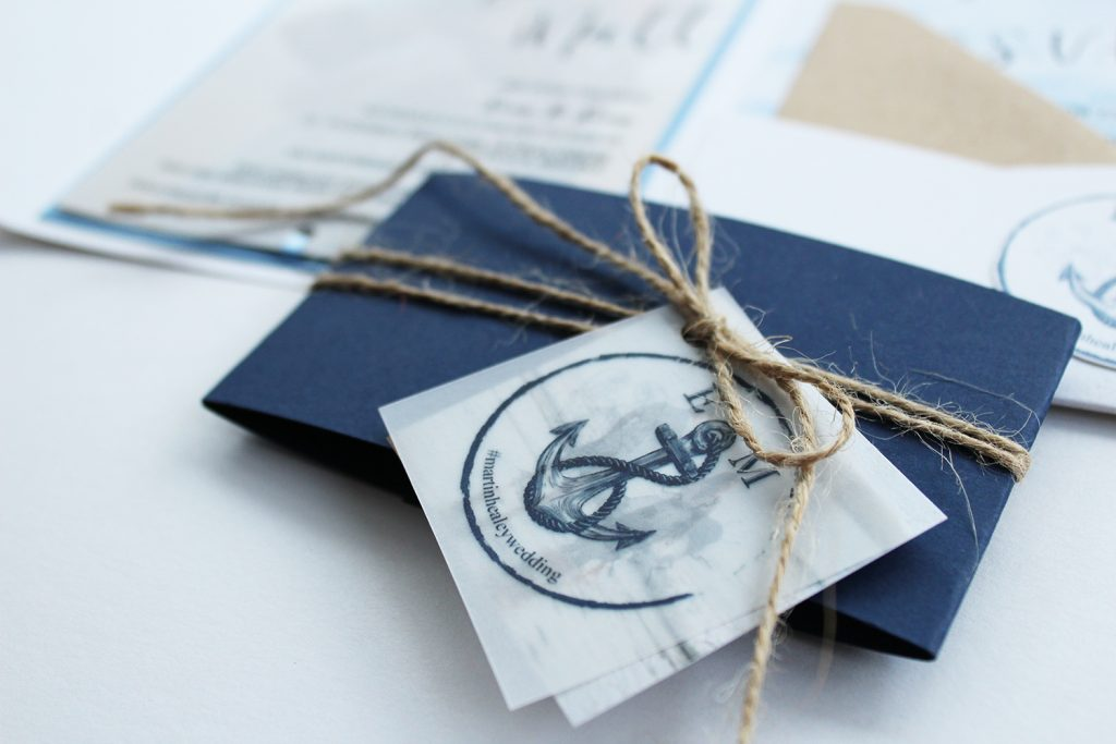 diy wedding invitations detail image navy belly band twine bow vellum logo tag