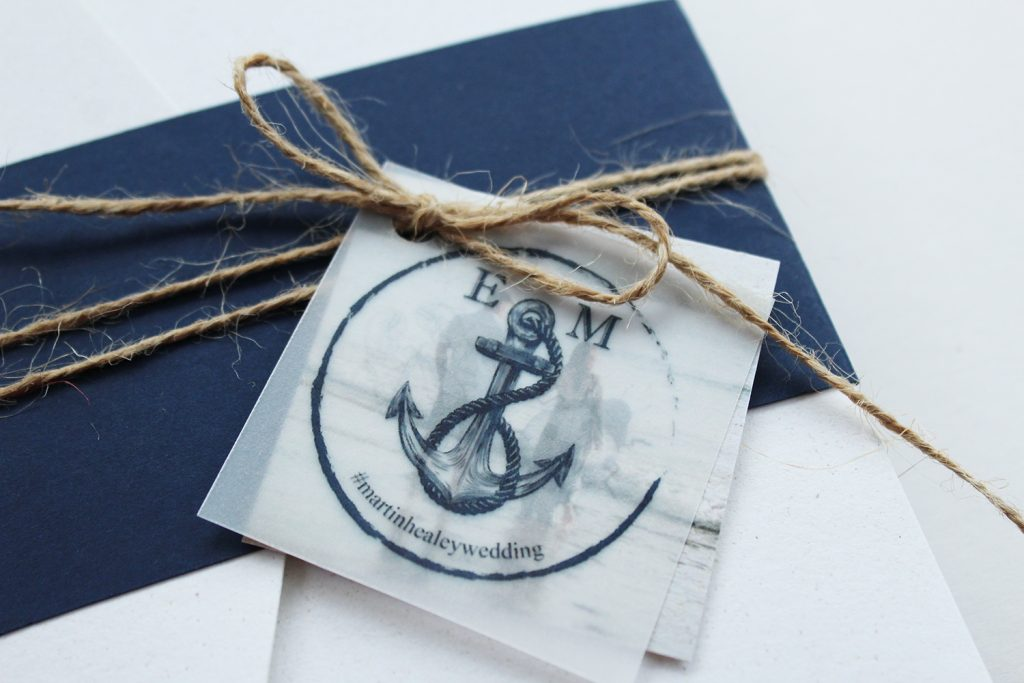 diy wedding invitations close up navy belly band twine bow vellum logo tag