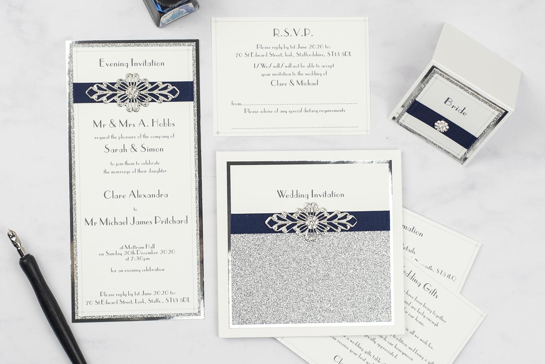 luxury wedding invites invitation suite flatlay silver foil glitter crystal embellishment navy ribbon